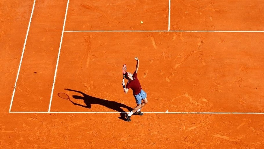 Swiss player Roger Federer serves to Guillermo Garcia Lopez of Spain during their match of the Monte Carlo Tennis Masters tournament in Monaco, Tuesday, April 12, 2016. (AP Photo/Lionel Cironneau)