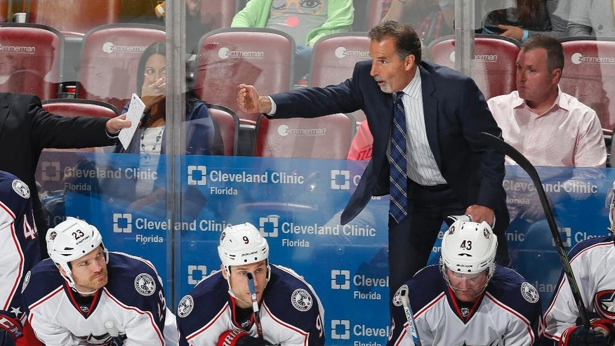 In this Dec. 27, 2015 photo, Columbus Blue Jackets coach John Tortorella signals goaltender Curtis McElhinney to skate to the bench for an extra skater during the third period of an NHL hockey game in Sunrise, Fla. With a core of young, talented players secured for the next few years, the Blue Jackets try to look past a dismal 2015-16 season. (AP Photo/Joel Auerbach)