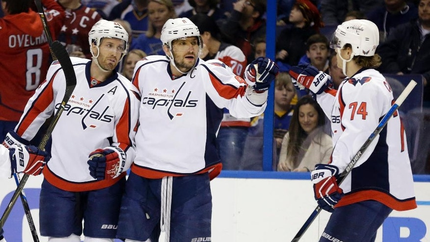 Washington Capitals' Alex Ovechkin, of Russia, is congratulated by John Carlson, right, and Brooks Orpik, left, after scoring during the first period of an NHL hockey game against the St. Louis Blues, Saturday, April 9, 2016, in St. Louis. (AP Photo/Jeff Roberson)