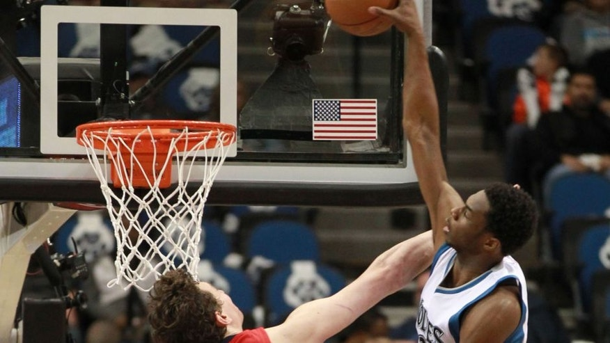 <p>Minnesota Timberwolves Andrew Wiggins (22) dunks on New Orleans Pelicans Omer Asik in the half of an NBA basketball game Monday, April 13, 2015, in Minneapolis. (AP Photo/Andy Clayton-King)</p>