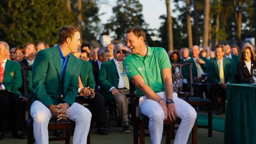 Defending champion Jordan Spieth, left, talks to 2016 winner Danny Willett, of England, before presentations for the Masters golf tournament Sunday, April 10, 2016, in Augusta, Ga. (AP Photo/David J. Phillip)