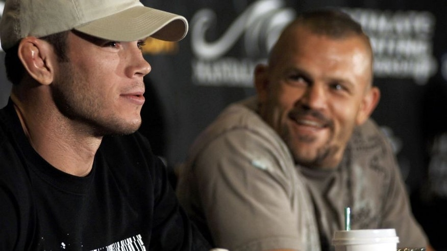 LAS VEGAS - AUGUST 24: UFC Light Heavyweight Champion Chuck Liddell (R) laughs as Forrest Griffin jokes about his fight at UFC 62 during a press conference at Mandalay Bay Event Center August 24, 2006 in Las Vegas, Nevada. (Photo by David S. Holloway/Getty Images)