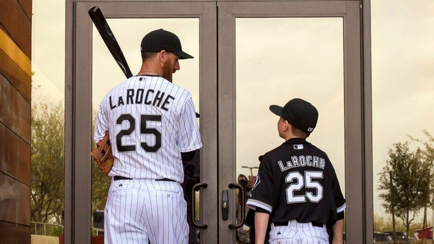 First baseman Adam LaRoche walks back into the clubhouse with his son Drake, 13, after photo day Saturday, Feb. 28, 2015 at Chicago White Sox spring training in Glendale, Ariz. (Brian Cassella/Chicago Tribune/TNS),First baseman Adam LaRoche walks back into the clubhouse with his son Drake, 13, after photo day Saturday, Feb. 28, 2015 at Chicago White Sox spring training in Glendale, Ariz. (Brian Cassella/Chicago Tribune/TNS via Getty Images)