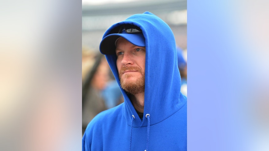 Dale Earnhardt Jr. stands on the track before the NASCAR Sprint Cup Series auto race at Texas Motor Speedway in Fort Worth, Texas, Saturday, April 9, 2016. (AP Photo/Randy Holt)