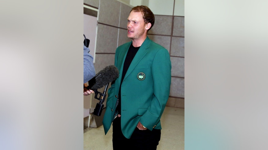 Britain's Danny Willett speaks to the media as he arrives at Manchester Airport, England, Tuesday April 12, 2016, after his victory at the Masters on Sunday. Willett arrived back in Britain having become the first European to win the Masters since 1999 and only the second English player to receive the green jacket. (Martin Rickett/PA via AP) UNITED KINGDOM OUT