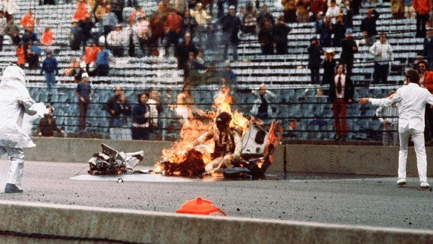 This Wednesday, May 30, 1973, file photo, shows Swede Savage amid the wreckage of his race car after a crash during the Indianapolis 500 auto race in Indianapolis, Ind. (AP Photo/File)