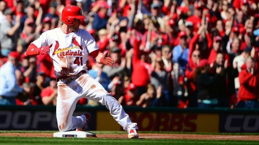 ST. LOUIS, MO - APRIL 11: Jeremy Hazelbaker #41 of the St. Louis Cardinals celebrates after hitting a triple during the first inning of the home opener at Busch Stadium against the Milwaukee Brewers on April 11, 2016 in St. Louis, Missouri. (Photo by Jeff Curry/Getty Images)