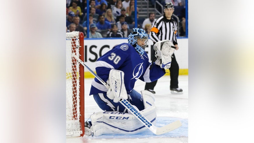 Tampa Bay Lightning goalie Ben Bishop (30) makes a glove save on a shot by the Detroit Red Wings during the first period of Game 1 of a first-round NHL hockey Stanley Cup playoff series Wednesday, April 13, 2016, in Tampa, Fla. (AP Photo/Chris O'Meara)