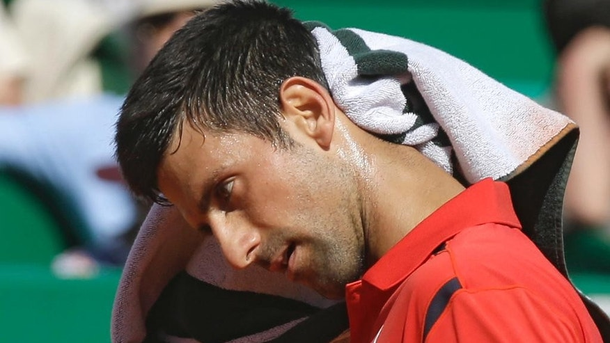 Novak Djokovic of Serbia reacts during his match of the Monte Carlo Tennis Masters tournament against Jiri Vesely of Czech Republic, in Monaco, Wednesday, April 13, 2016. (AP Photo/Lionel Cironneau)