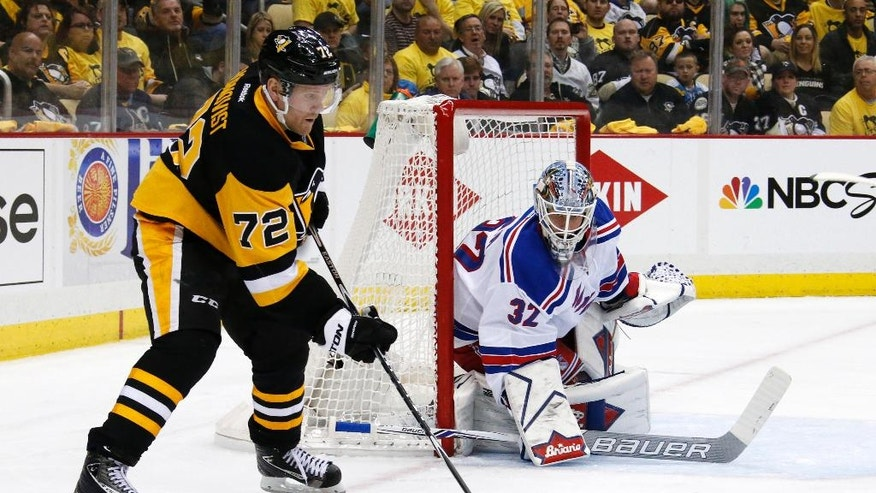 Pittsburgh Penguins' Patric Hornqvist (72) works to get a shot off in front of New York Rangers goalie Antti Raanta (32) during the second period of a first-round NHL playoff hockey game in Pittsburgh, Wednesday, April 13, 2016. (AP Photo/Gene J. Puskar)