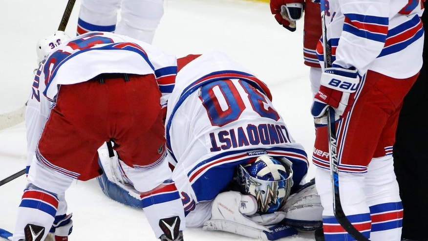 New York Rangers goalie Henrik Lundqvist (30) kneels on the ice after getting a stick to the face during the first period of a first-round NHL playoff hockey game against the New York Rangers in Pittsburgh, Wednesday, April 13, 2016. Lundqvist left the game after the first period. (AP Photo/Gene J. Puskar)