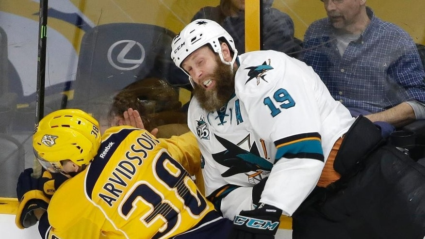 FILE - In this April 2, 2016 file photo, San Jose Sharks center Joe Thornton (19) and Nashville Predators forward Viktor Arvidsson (38), of Sweden, hit the glass as they chase the puck during the first period of an NHL hockey game in Nashville, Tenn. Thornton has had a career renaissance at age 36 to help lead San Jose back to the playoffs. (AP Photo/Mark Humphrey, FIle)
