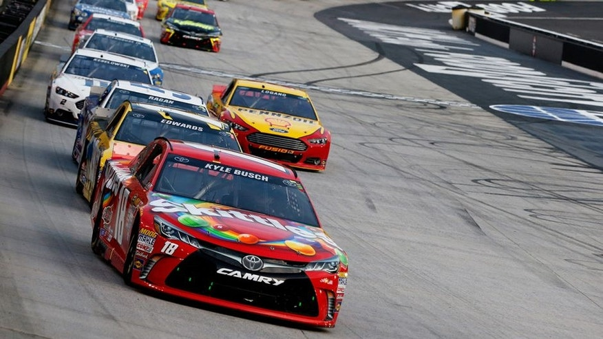 BRISTOL, TN - AUGUST 22: Kyle Busch, driver of the #18 Skittles Toyota, leads a pack of cars during the NASCAR Sprint Cup Series IRWIN Tools Night Race at Bristol Motor Speedway on August 22, 2015 in Bristol, Tennessee. (Photo by Brian Lawdermilk/Getty Images)