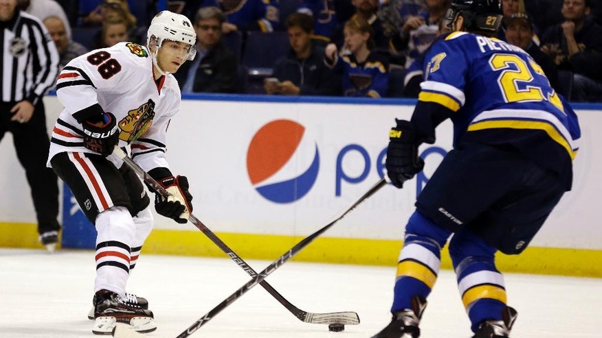 Chicago Blackhawks' Patrick Kane, left, looks to pass around St. Louis Blues' Alex Pietrangelo during the first period in Game 1 of an NHL hockey first-round Stanley Cup playoff series Wednesday, April 13, 2016, in St. Louis. (AP Photo/Jeff Roberson)