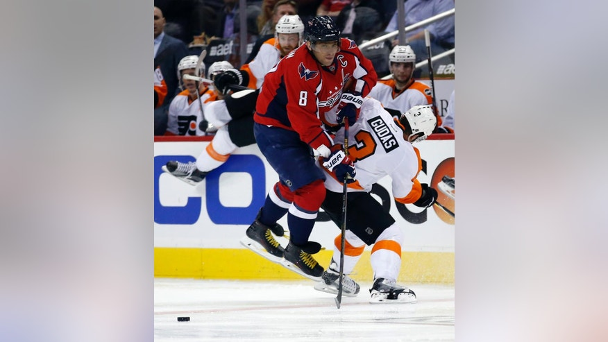 Washington Capitals left wing Alex Ovechkin (8), from Russia, collides with Philadelphia Flyers defenseman Radko Gudas (3), from the Czech Republic, during the second period of Game 1 of a first-round NHL hockey Stanley Cup playoff series Thursday, April 14, 2016, in Washington. (AP Photo/Alex Brandon)