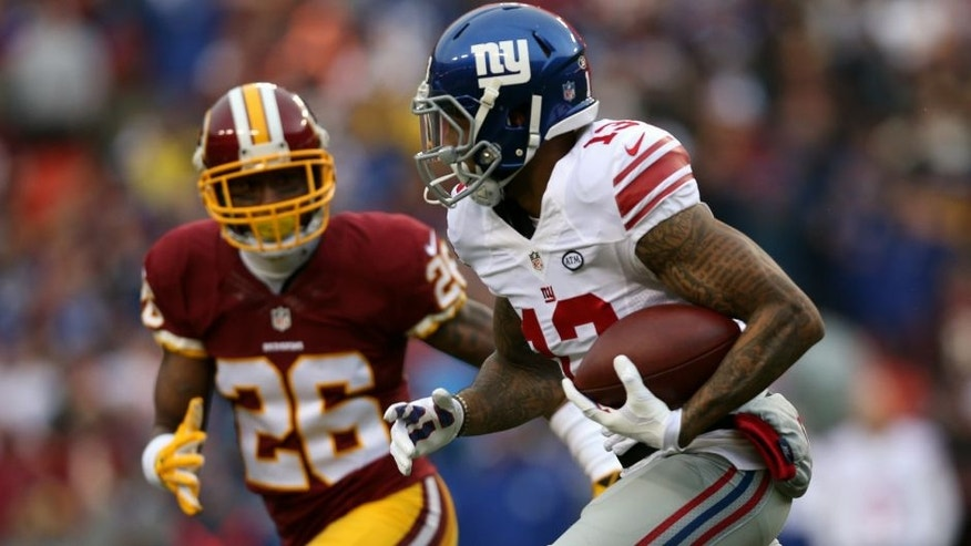 LANDOVER, MD - NOVEMBER 29: Wide receiver Odell Beckham #13 of the New York Giants carries the ball against cornerback Bashaud Breeland #26 of the Washington Redskins in the first quarter at FedExField on November 29, 2015 in Landover, Maryland. (Photo by Patrick Smith/Getty Images)