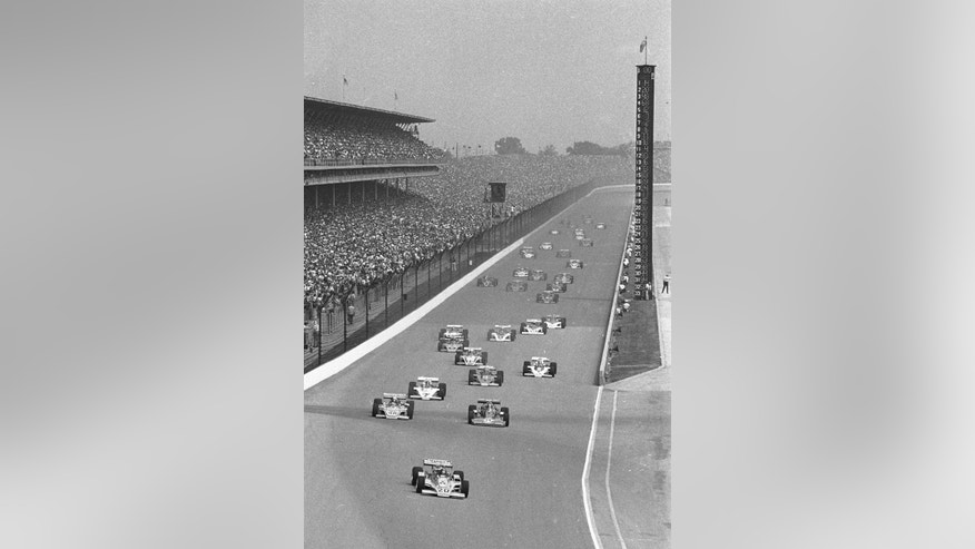 FILE - In this May 25, 1975 file photo, Gordon Johncock in the Wildcat-Turbo Drake (20) leads pole holder A.J. Foyt in his Coyote-Turbo Foyt (14) at start of 59th running of the Indianapolis 500 auto race at Indianapolis Motor Speedway in Indianapolis, Ind.  (AP Photo/File)