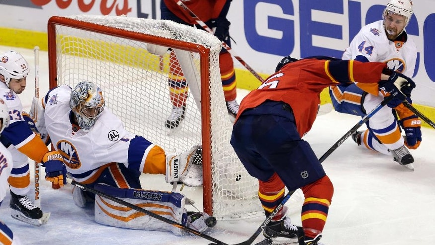 New York Islanders goalie Thomas Greiss blocks a shot by Florida Panthers center Aleksander Barkov (16) during the second period of Game 1 in a first-round NHL hockey Stanley Cup playoff series, Thursday, April 14, 2016, in Sunrise, Fla. (AP Photo/Alan Diaz)