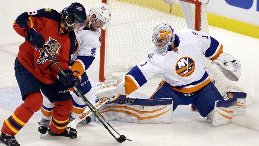 New York Islanders goalie Thomas Greiss (1) blocks a shot as Calvin de Haan (44) defends Florida Panthers right wing Jaromir Jagr (68) during the second period of Game 1 in a first-round NHL hockey Stanley Cup playoff series, Thursday, April 14, 2016, in Sunrise, Fla. (AP Photo/Alan Diaz)
