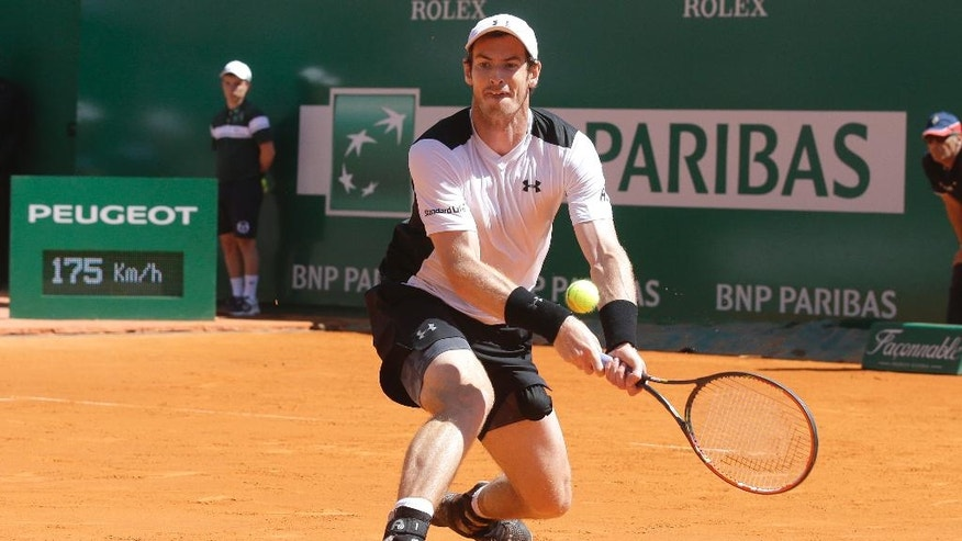 Andy Murray of Britain plays a return to France's Benoit Paire during their match of the Monte Carlo Tennis Masters tournament in Monaco, Thursday, April 14, 2016. (AP Photo/Lionel Cironneau)
