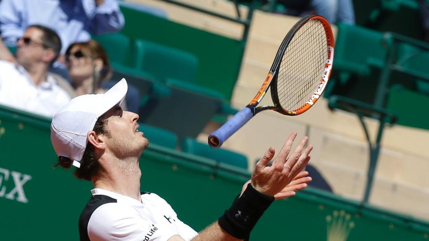Andy Murray of  Britain throws his racket  during his match of the Monte Carlo Tennis Masters tournament against France's Benoit Paire, in Monaco, Thursday, April 14, 2016. (AP Photo/Lionel Cironneau)