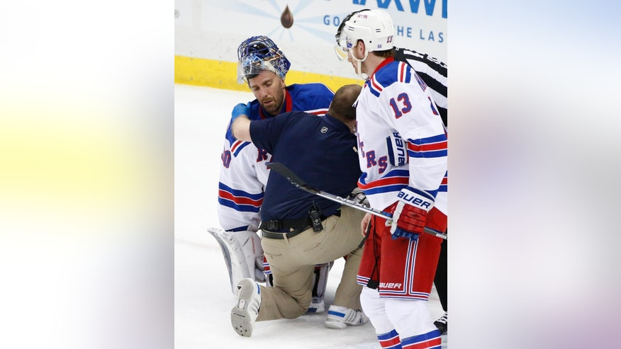 New York Rangers goalie Henrik Lundqvist (30) is helped by a trainer after getting a stick to the face during the first period of a first-round NHL playoff hockey game against the New York Rangers  in Pittsburgh, Wednesday, April 13, 2016. Lundqvist left the game after the first period. (AP Photo/Gene J. Puskar)