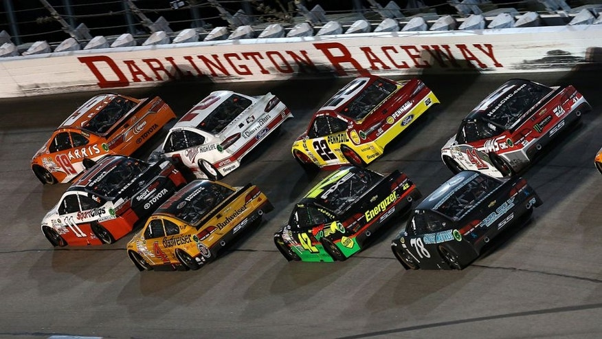 DARLINGTON, SC - SEPTEMBER 06: Carl Edwards, driver of the #19 ARRIS Toyota, leads a pack of cars during the NASCAR Sprint Cup Series Bojangles' Southern 500 at Darlington Raceway on September 6, 2015 in Darlington, South Carolina. (Photo by Sarah Crabill/NASCAR via Getty Images)