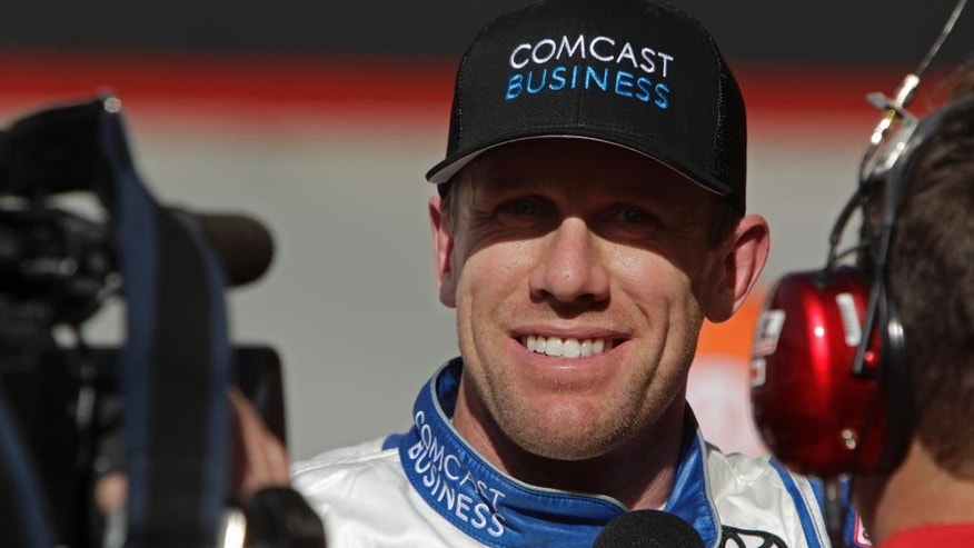 Sprint Cup Series driver Carl Edwards (19) smiles as he is interviewed after winning the pole for a NASCAR auto race, Friday, April 15, 2016 in Bristol, Tenn. (AP Photo/Wade Payne)