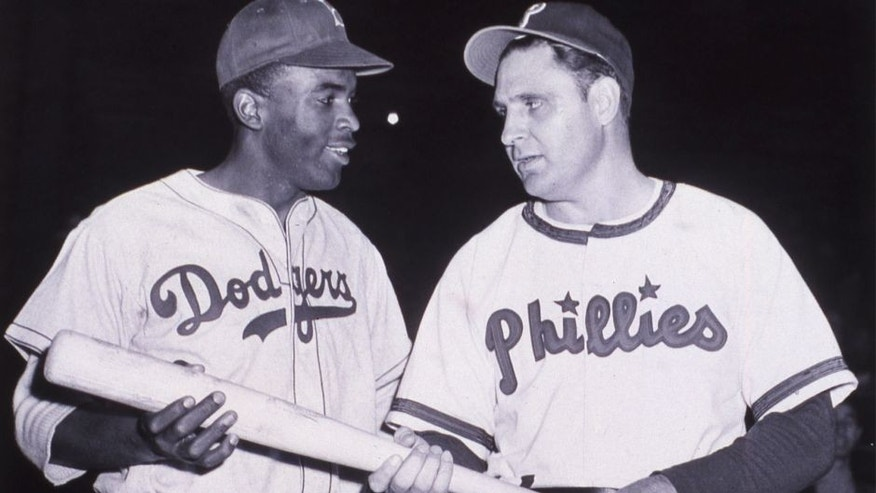 <p>Jackie Robinson of the Brooklyn Dodgers, left, talks with nemesis Ben Chapman of the Philadelphia Phillies in the middle of the 1947 N.L. season. (Photo by Mark Rucker/Transcendental Graphics, Getty Images)</p>
