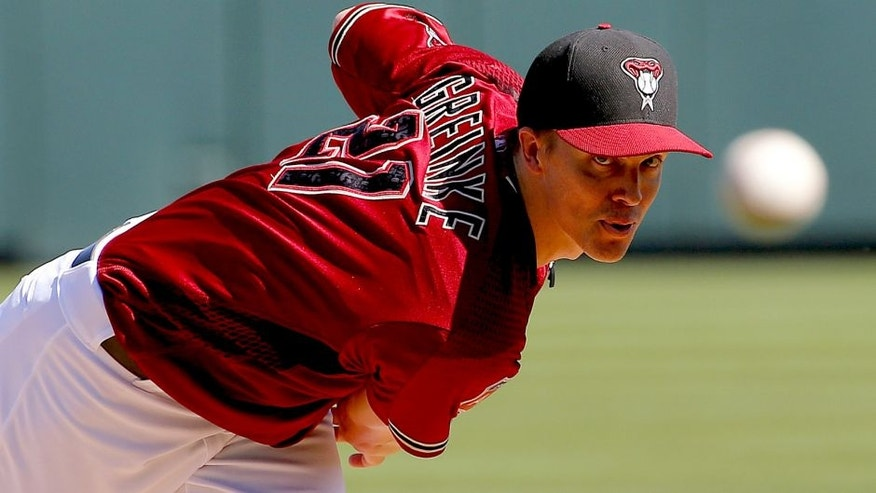 RETRANSMISSION TO CORRECT SPELLING OF NAME TO ZACK FROM ZACH - Arizona Diamondbacks' Zack Greinke warms up between innings against the Oakland Athletics during a spring training baseball game, Friday, March 4, 2016, in Scottsdale, Ariz. (AP Photo/Matt York)