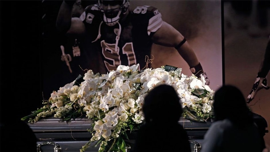 <p>People view the casket of New Orleans Saints defensive end Will Smith during a public viewing at the NFL football team's training facility in Metairie, La., Friday, April 15, 2016. Smith was shot to death last Saturday, and his wife wounded by gunfire, after an altercation following a traffic accident last Saturday. (AP Photo/Gerald Herbert)</p>
