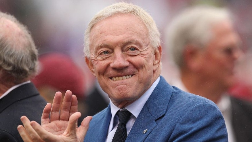 Oct 11, 2014; Fayetteville, AR, USA; Dallas Cowboys owner Jerry Jones is honored along with his teammates from the 1964 team prior to the game between the Alabama Crimson Tide and the Arkansas Razorbacks at Donald W. Reynolds Razorback Stadium. Mandatory Credit: Nelson Chenault-USA TODAY Sports