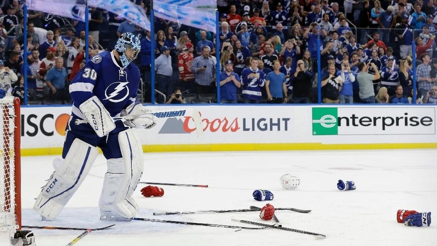 Tampa Bay Lightning goalie Ben Bishop skates around equipment after a fight during the third period of Game 2 in a first-round NHL hockey Stanley Cup playoff series between the Lightning and the Detroit Red Wings, Friday, April 15, 2016, in Tampa, Fla. The Lightning won 5-2. (AP Photo/Chris O'Meara)