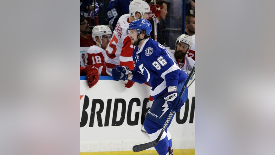 Tampa Bay Lightning right wing Nikita Kucherov (86), of Russia, celebrates after scoring against the Detroit Red Wings during the first period of Game 2 in a first-round NHL hockey Stanley Cup playoff series Friday, April 15, 2016, in Tampa, Fla. (AP Photo/Chris O'Meara)