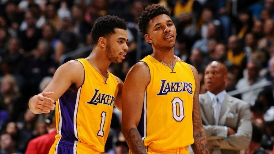 LOS ANGELES, CA - FEBRUARY 19: D'Angelo Russell #1 of the Los Angeles Lakers and Nick Young #0 of the Los Angeles Lakers talk during the game against the San Antonio Spurs on February 19, 2016 at STAPLES Center in Los Angeles, California. NOTE TO USER: User expressly acknowledges and agrees that, by downloading and/or using this Photograph, user is consenting to the terms and conditions of the Getty Images License Agreement. Mandatory Copyright Notice: Copyright 2016 NBAE (Photo by Juan Ocampo/NBAE via Getty Images)