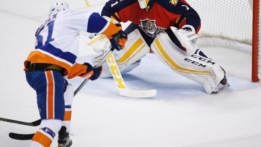 New York Islanders center Frans Nielsen (51) attempts to shoot against Florida Panthers goalie Roberto Luongo (1) during the first period of Game 2 in a first-round NHL hockey Stanley Cup playoff series, Friday, April 15, 2016, in Sunrise, Fla. (AP Photo/Wilfredo Lee)