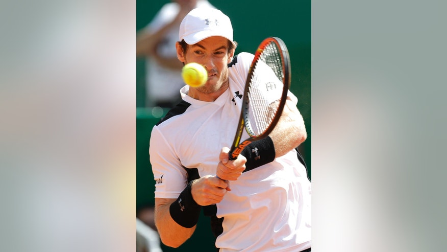 Andy Murray of Britain plays a return to Canada's Milos Raonic during their quarterfinal match of the Monte Carlo Tennis Masters tournament in Monaco, Friday, April 15, 2016. (AP Photo/Lionel Cironneau)