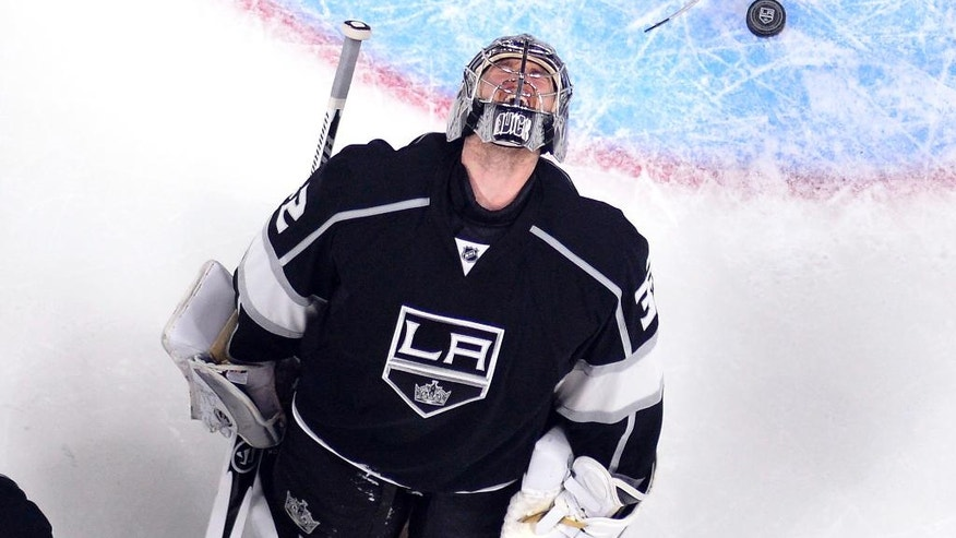 Los Angeles Kings goalie Jonathan Quick reacts after being scored on by San Jose Sharks' Tomas Hertl, of the Czech Republic, during the second period of Game 1 in an NHL hockey Stanley Cup playoffs first-round series, Thursday, April 14, 2016, in Los Angeles. (AP Photo/Mark J. Terrill)