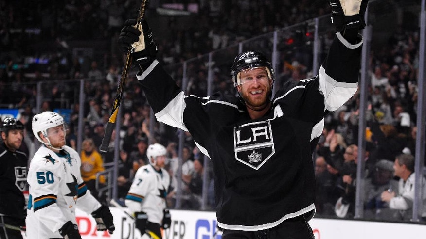 Los Angeles Kings center Jeff Carter, right, celebrates his goal during the second period of Game 1 in an NHL hockey Stanley Cup playoffs first-round series against the San Jose Sharks, Thursday, April 14, 2016, in Los Angeles. (AP Photo/Mark J. Terrill)