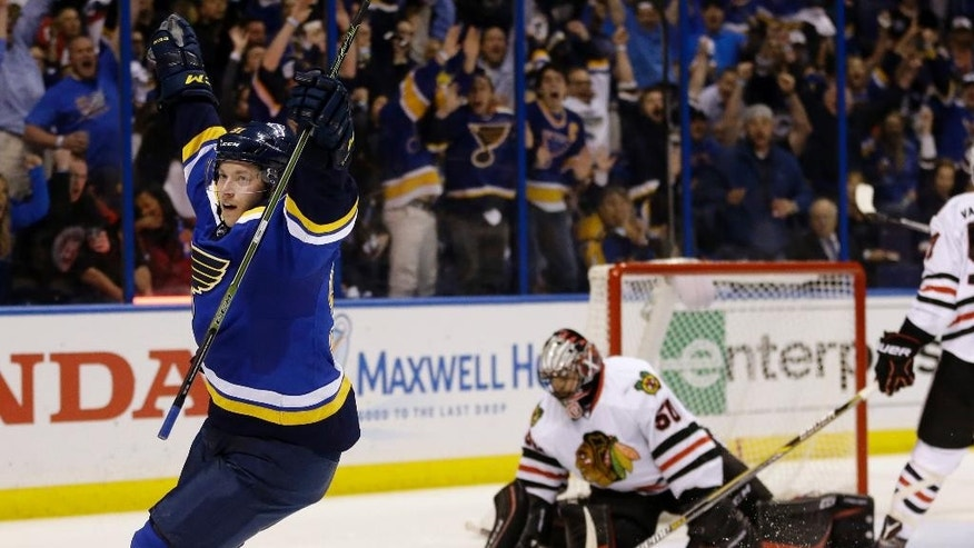 St. Louis Blues' Vladimir Tarasenko, left, of Russia, celebrates after scoring past Chicago Blackhawks goalie Corey Crawford,  second from left,  during the second period in Game 2 of an NHL hockey first-round Stanley Cup playoff series Friday, April 15, 2016, in St. Louis. (AP Photo/Jeff Roberson)