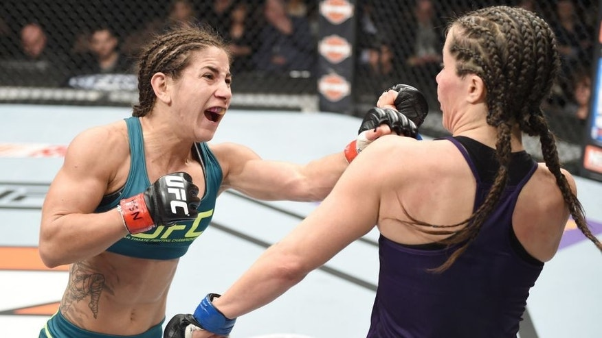 LAS VEGAS, NEVADA - DECEMBER 12: (L-R) Tecia Torres punches Angela Magana in their strawweight fight during The Ultimate Fighter Finale event inside the Pearl concert theater at the Palms Casino Resort on December 12, 2014 in Las Vegas, Nevada. (Photo by Jeff Bottari/Zuffa LLC/Zuffa LLC via Getty Images)