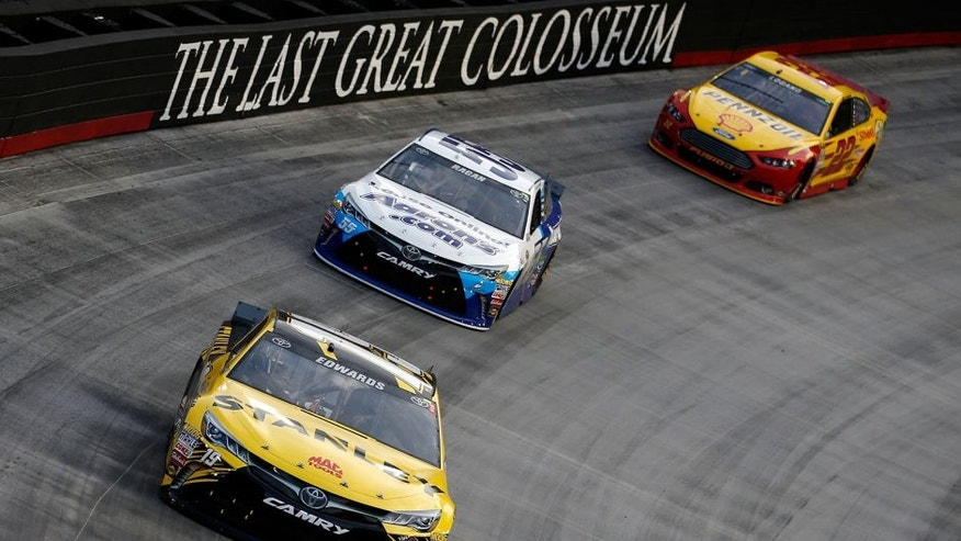 BRISTOL, TN - AUGUST 22: Carl Edwards, driver of the #19 Stanley Toyota, leads David Ragan, driver of the #55 Aaron's Online Dream Machine Toyota, and Joey Logano, driver of the #22 Shell Pennzoil Ford, during the NASCAR Sprint Cup Series IRWIN Tools Night Race at Bristol Motor Speedway on August 22, 2015 in Bristol, Tennessee. (Photo by Gregory Shamus/Getty Images)