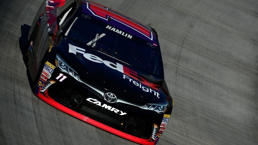 BRISTOL, TN - APRIL 16: Denny Hamlin, driver of the #11 FedEx Freight Toyota, practices for the NASCAR Sprint Cup Series Food City 500 at Bristol Motor Speedway on April 16, 2016 in Bristol, Tennessee. (Photo by Robert Laberge/Getty Images)