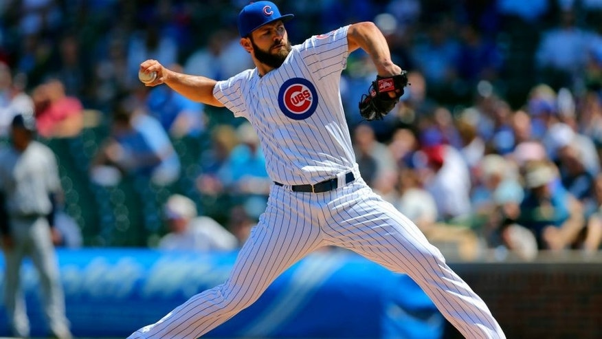 <p>May 2, 2015; Chicago, IL, USA; Chicago Cubs starting pitcher Jake Arrieta (49) delivers a pitch during the first inning against the Milwaukee Brewers at Wrigley Field. Mandatory Credit: Dennis Wierzbicki-USA TODAY Sports</p>