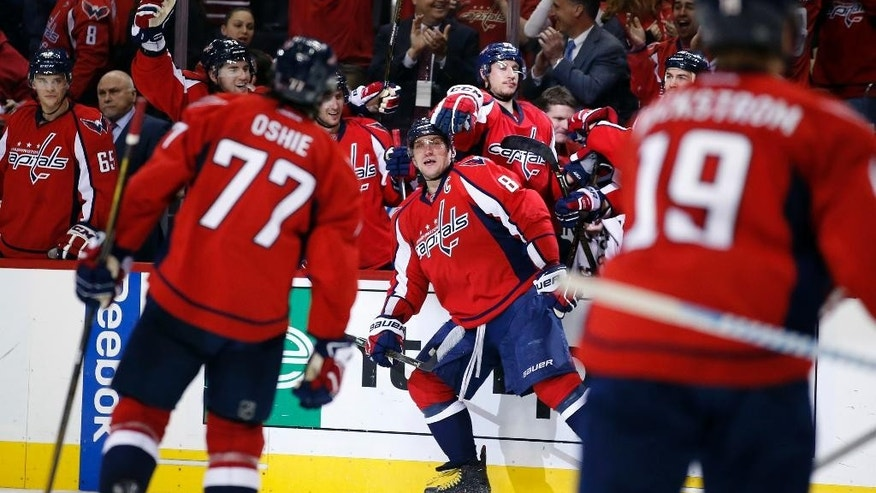 CORRECTS TO GAME 2, INSTEAD OF GAME 1  - Washington Capitals left wing Alex Ovechkin (8), from Russia, celebrates his goal during the second period of Game 2 in the first round of the NHL Stanley Cup hockey playoffs against the Philadelphia Flyers, Saturday, April 16, 2016, in Washington. (AP Photo/Alex Brandon)