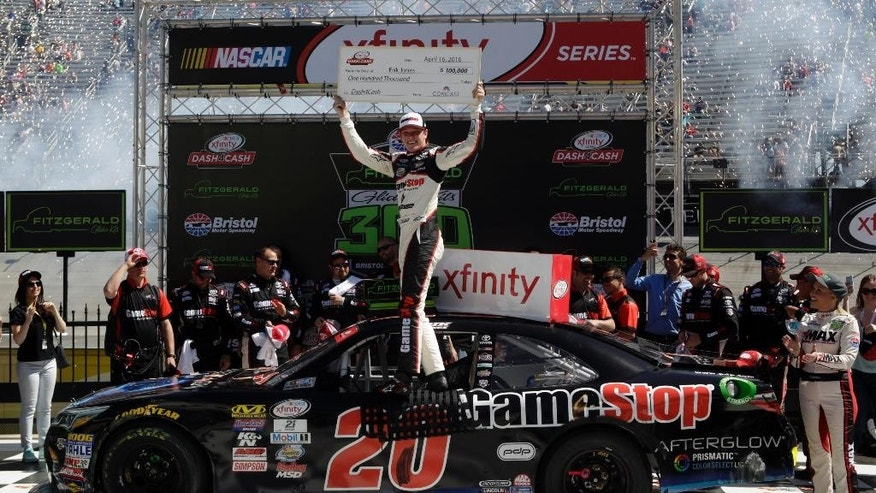 Driver Erik Jones (20) celebrates in Victory Lane after winning a NASCAR Xfinity Series auto race on Saturday, April 16, 2016 in Bristol, Tenn. (AP Photo/Wade Payne)
