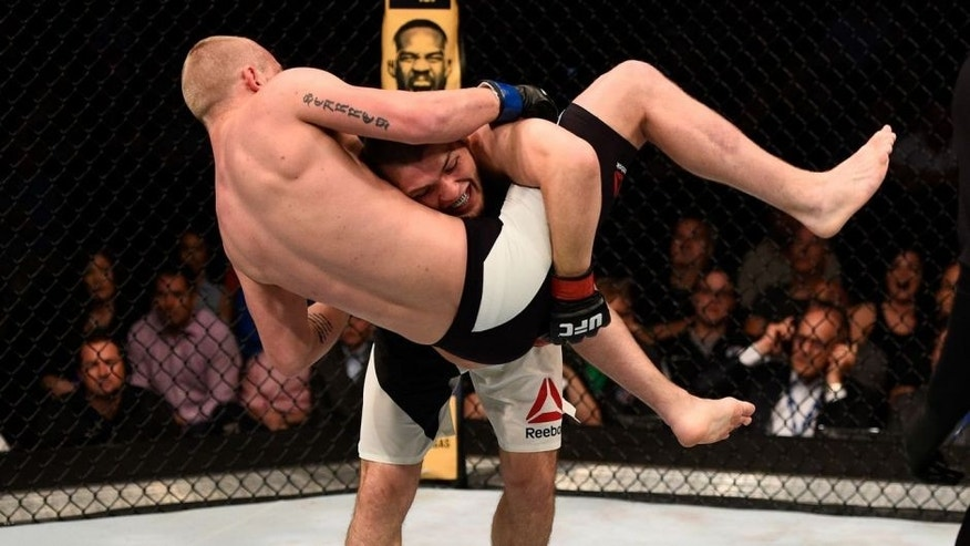 TAMPA, FL - APRIL 16: (R-L) Khabib Nurmagomedov takes down Darrell Horcher in their lightweight bout during the UFC Fight Night event at Amalie Arena on April 16, 2016 in Tampa, Florida. (Photo by Jeff Bottari/Zuffa LLC/Zuffa LLC via Getty Images)