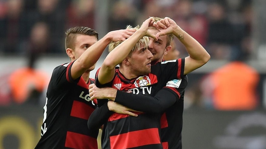 Leverkusen's Kevin Kampl celebrates after scoring the first goal during the German Bundesliga soccer match between Bayer Leverkusen and Eintracht Frankfurt in Leverkusen, Germany, Saturday, April 16, 2016. (AP Photo/Martin Meissner)