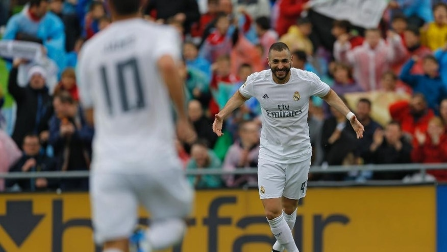 Real Madrid's Karim Benzema celebrates after scoring the opening goal against Getafe during a Spanish La Liga soccer match between Real Madrid and Getafe at the Alfonso Perez stadium in Getafe, near Madrid, Saturday, April 16, 2016. (AP Photo/Francisco Seco)