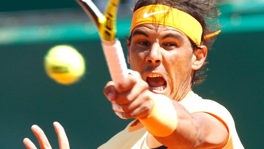 Spain's Rafael Nadal plays a return to Andy Murray of Great Britain during their semi final match of the Monte Carlo Tennis Masters tournament in Monaco, Saturday, April 16, 2016. (AP Photo/Lionel Cironneau)